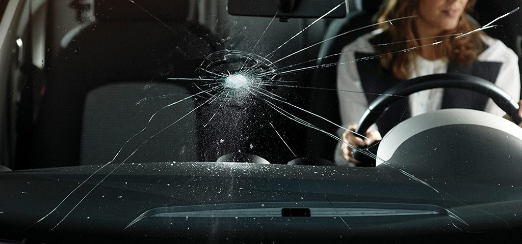 What causes cracks in the windshield of cars